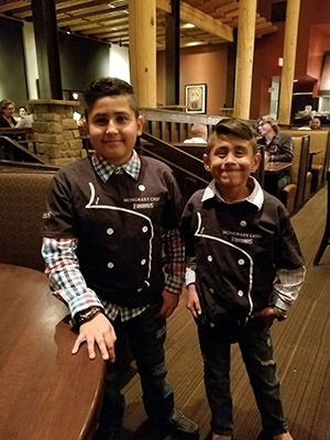 Kids_Showing_Off_Their_Complimentary_Firebirds_Chefs_Jackets.jpg