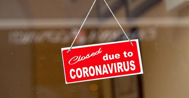 "Sign reading ""closed due to coronavirus"""