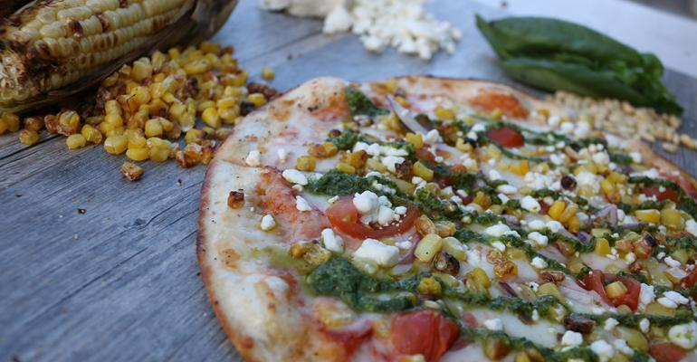 Item Pesto Primavera pizza pizza crust topped with red sauce allnatural Italian cheese roasted corn crumbled goat cheese red onion cherry tomatoes and a pesto drizzle under 600 calories 825Availability Through March 31