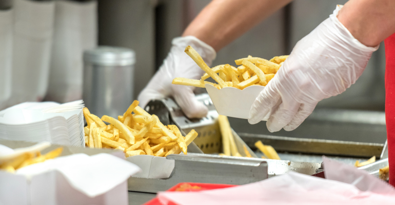 fast-food-restaurant-worker-getty-promo.png