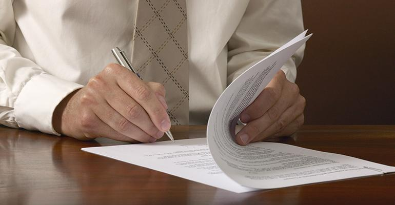lawyer-signing-document.jpg