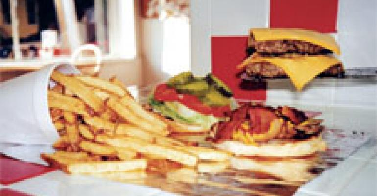 Fast-grown Five Guys chain beefs up, eyes meaty growth