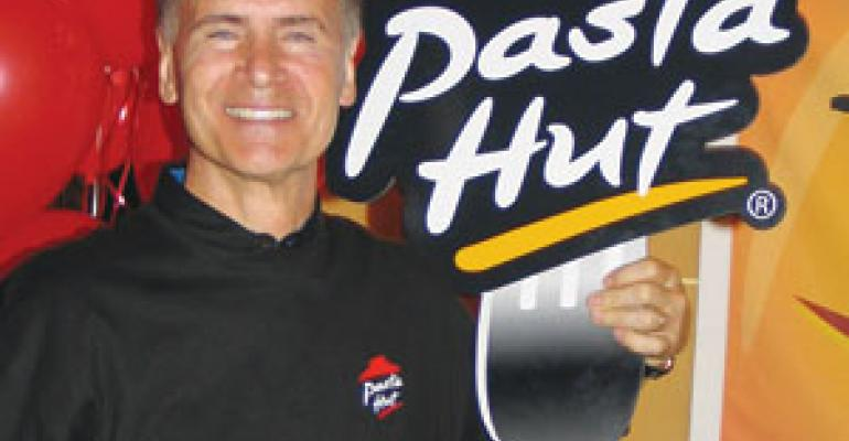 Pizza Hut fights slump with pasta delivery