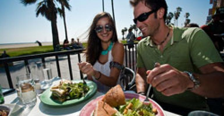 Restaurants add jobs to feed summer travelers