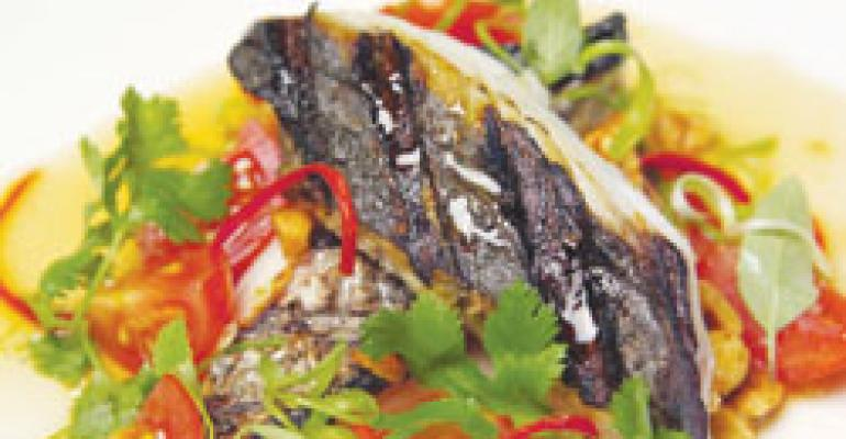 Grilled mackerel salad with garlic-chile-lime dressing