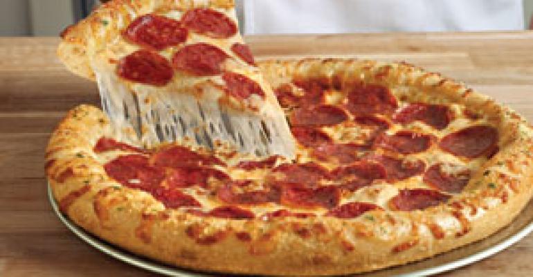 Domino's new pizza delivers sales surge