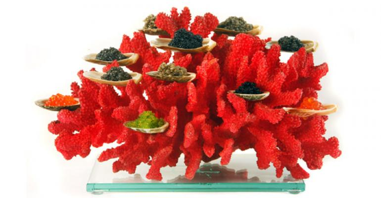 Chef Anthony Martin serves a Coral Caviar presentation at Tru in Chicago