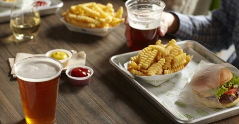 Craft beers accompany a Shack Burger and fries at Shake Shack