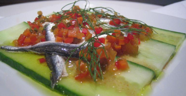 Sazerac serves marinated white anchovies topped with chowchow