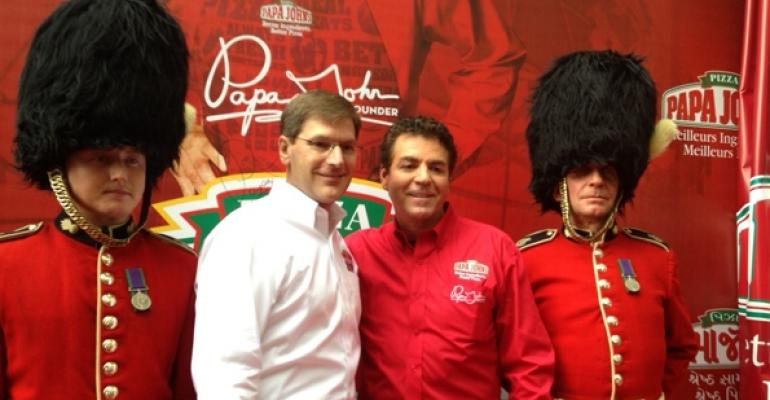 Papa Johns president and COO Tony Thompson second from left celebrates the chains 1000th international unit with founder and CEO John Schnatter