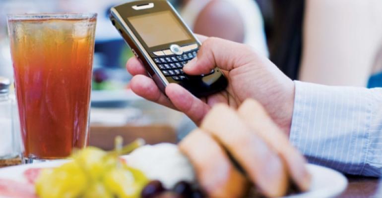 Smartphone in restaurant Thinkstock