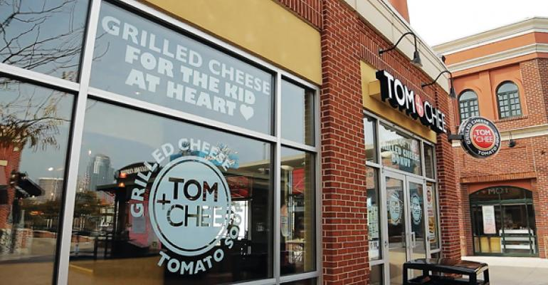Grilled cheese specialist Tom  Chee offers 25 sandwich options plus custom grilled cheese soups salads and what the brand calls Fancy Grilled Cheese Donuts