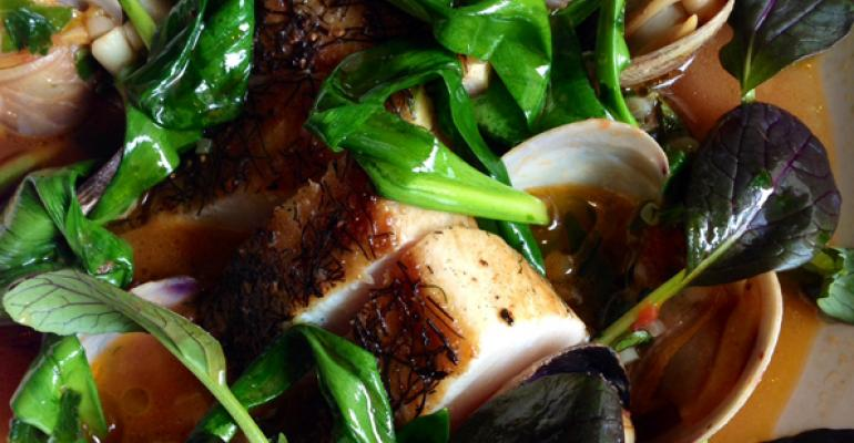 Chef Nick Anderer of Maialino in New York City pan sears the fish in his Pesce alla Piastra Seared Cobia with Manila Clam Stew and Ramps