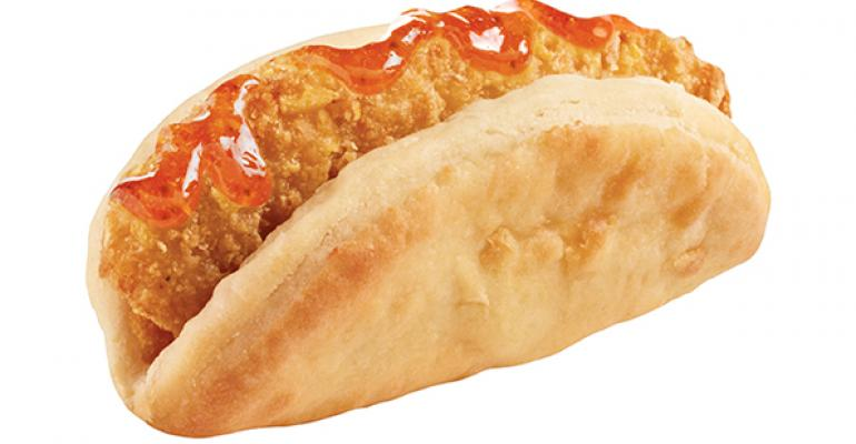 Taco Bell39s Biscuit Taco with crispy fried chicken and jalapenohoney sauce