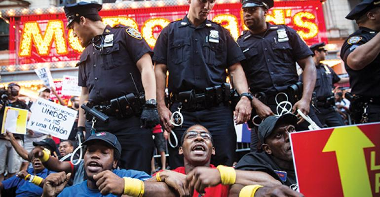 Protestors squared off with police at McDonald39s flagship on 42nd Street in New York