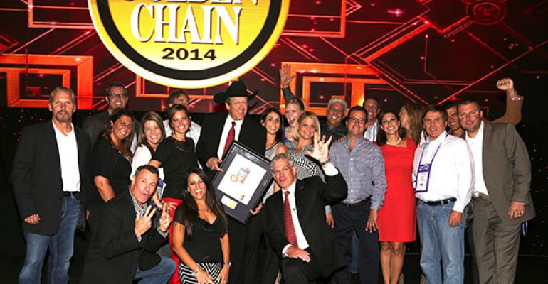 The Texas Roadhouse crew celebrates with Kent Taylor at the MUFSO Industry Awards Gala