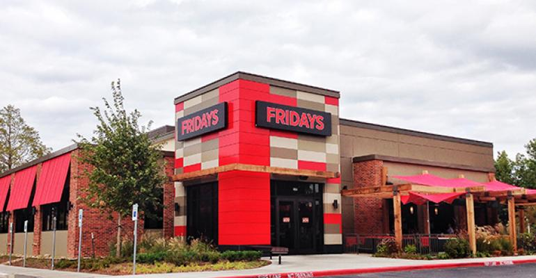 The redandwhite striped awnings are gone from new TGI Fridays prototype in Addison Texas