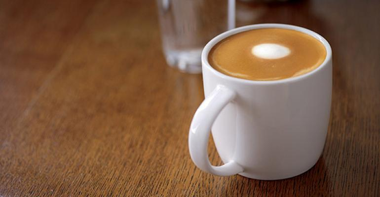 Starbucks Flat White coffee Two ristretto shots topped with a thin layer of ldquomicrofoamrdquo made by aerating the milk for 3 to 5 seconds mdash less time than for cappuccinos or lattes mdash and a latte art dot