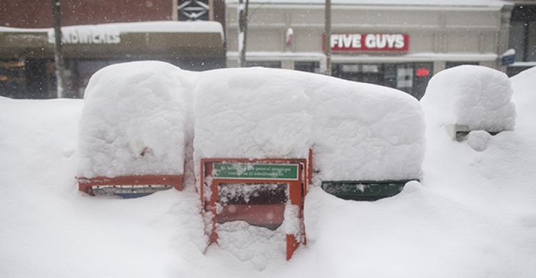 Snow covers downtown Boston in February Sales at restaurants and bars in the city fell 12 percent in January and February as the area was pounded by a series of snowstorms