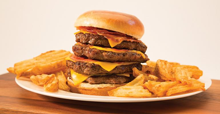 Wing Zone introduced the Widowmaker a hamburger with four quarterpound patties four slices of American cheese and four slices of bacon on a brioche bun