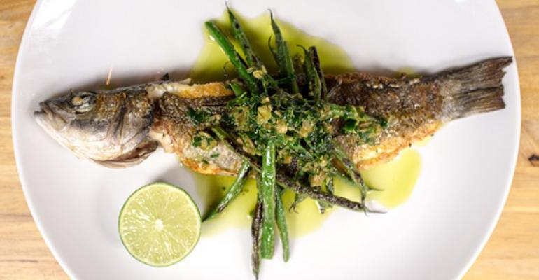 Whole Branzino topped with charred green beans is on the menu at Jeffreyrsquos Grocery in New York City