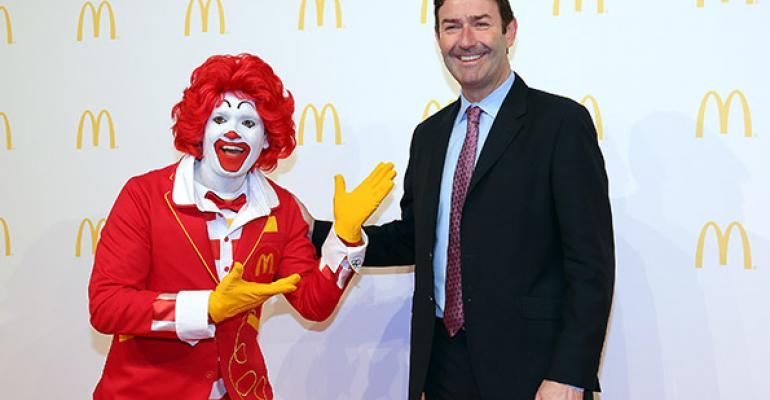 Steve Easterbrook CEO McDonald poses with Ronald McDonald during the new McDonald39s Flagship Restaurant reopening at Frankfurt International Airport