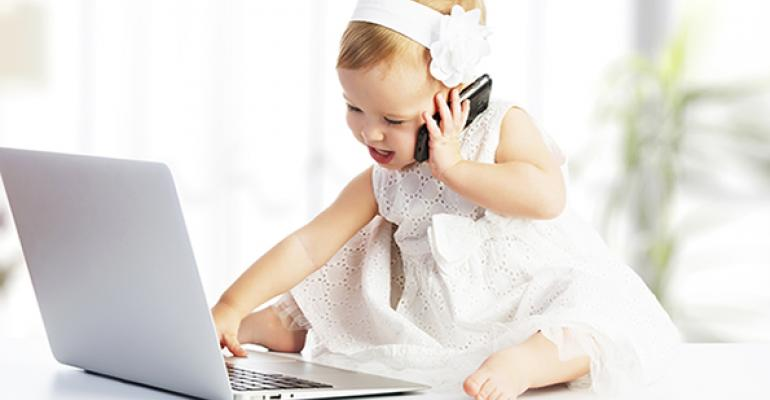 Baby with laptop and cell phone