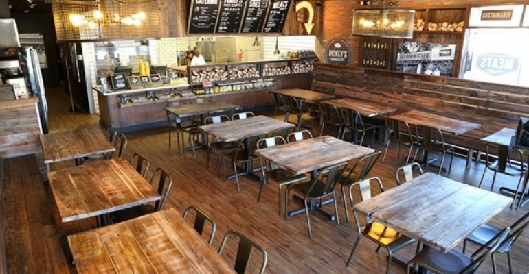 The dining room seating capacity remains the same featuring reclaimed woods and new branding