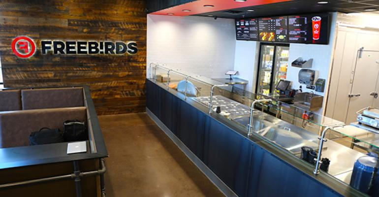 Freebirds order and assembly line features the introduction of digital menu boards and a passthrough walkin cooler for quick access by team members