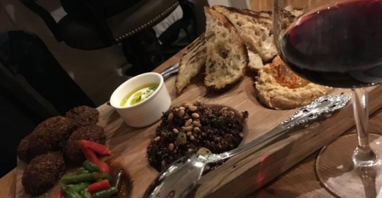 A Mediterranean tasting board at Tredici Enoteca in Philadelphia features hummus and falafel