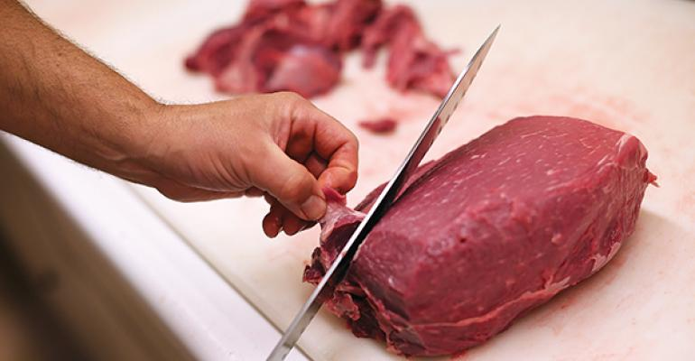 chef trimming beef