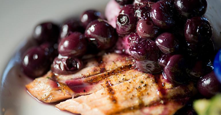 Sweet ripe blueberries meet savory salmon in the Oh So Blueberry Goat Cheese Alaska Salmon at Dukersquos Chowder House