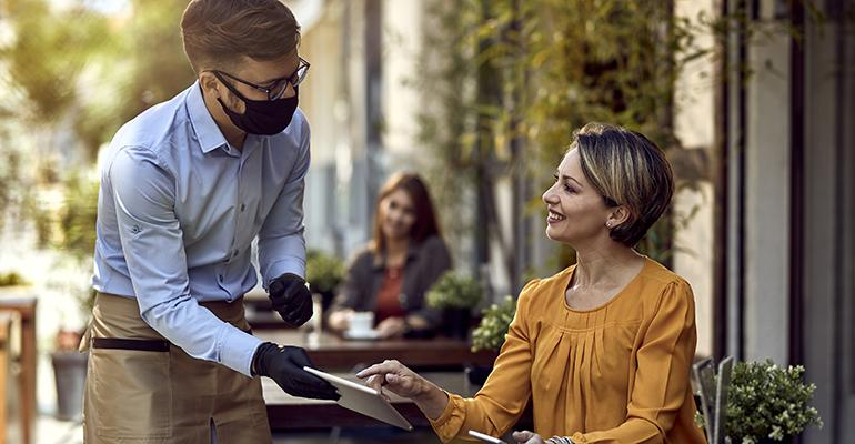 waiter-handing-check-at-restaurant-covid.jpg