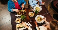 Young people eating lunch at restaurant.jpg