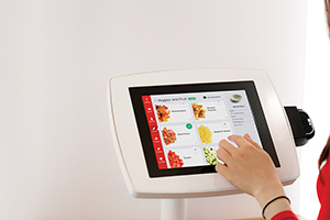Customers make their orders via iPad and pay with a credit card.