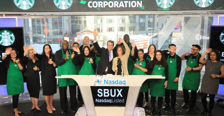 Starbucks employees ring the opening bell on the Nasdaq stock exchange Monday June 26.