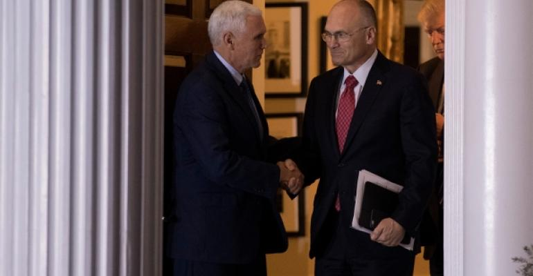 Andy Puzder CEO of CKE Restaurants shakes hands with vice presidentelect Mike Pence after a meeting in November Photo Drew AngererGetty Images