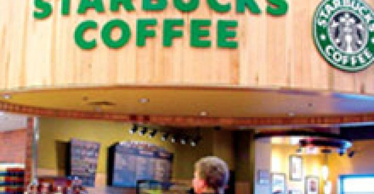 Starbucks scales back new stores, expects new drinks to perk up traffic