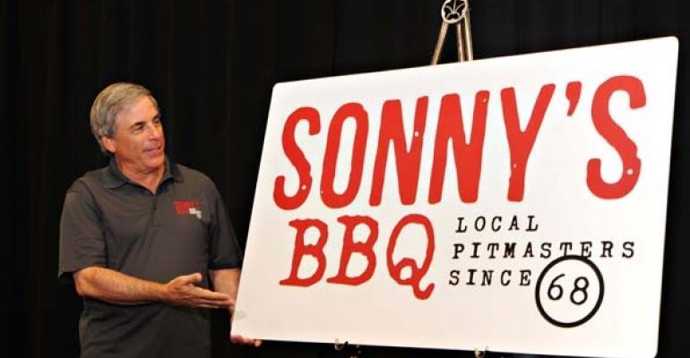 Sonnys CEO Bob Yarmuth unveils the companys new logo