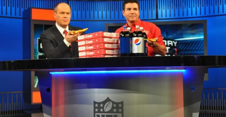Papa Johns founder John Schnatter right promotes the new deal on the NFL Network with Rich Eisen