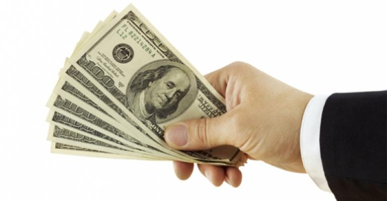 Hand with money Thinkstock