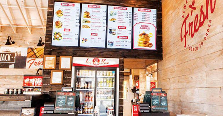 Slim Chickens has digital menu boards near its order counter
