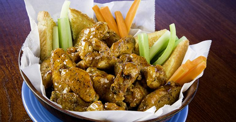 East Coast Wings amp Grill39s new Kamikaze wings are flavored with ginger molasses sesame crushed hot peppers vinegar garlic and salt