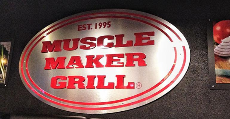 Muscle Maker Grill signage on interior wall