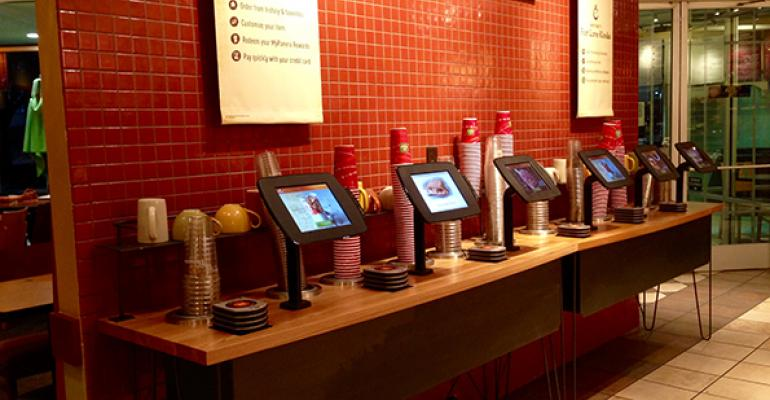 Kiosks lined up in former coffeeservice area of Dallas Panera Bread