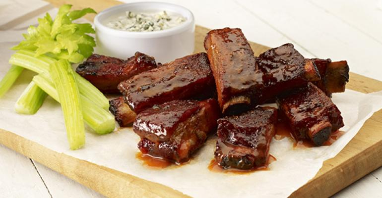 Famous Daversquos Buffalo Bones served with blue cheese dressing celery sticks and smoked blue cheese