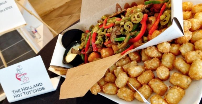 Texas Rangers pitcher Derek Holland has his name immortalized in the Holland Hot Totrsquochos menu introduction featuring tater tots a choice of chicken or steak sauteacuteed red and green bell peppers pickled jalapentildeos Buffalo sauce and spicy queso hollandaise served in a mini Dutch oven 1750