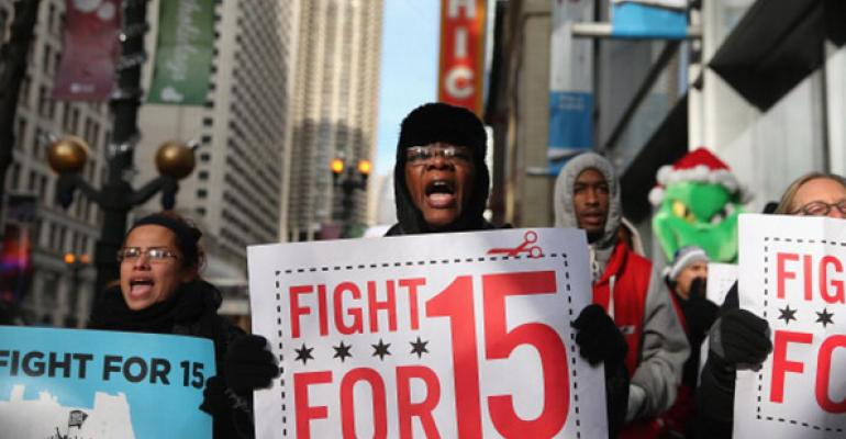 Demonstrators demanding an increase in pay for fastfood and retail workers protested in Chicago in December 2013