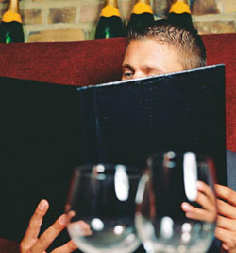 Upscale restaurants don't discount the danger to reputations as they turn to bargain promos
