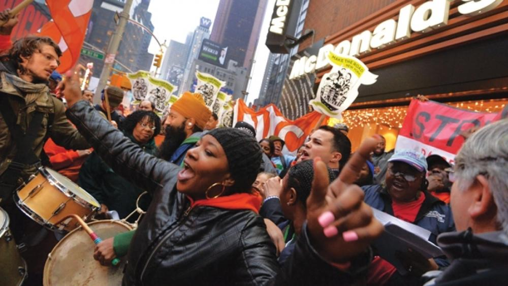 Protesters gather in front of a McDonalds in New York City